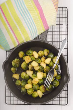 cast iron pan: roasted brussels sprouts with apple in a cast iron pan