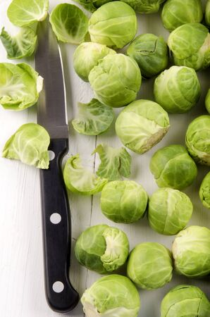 cleaned: cleaned brussels sprout and kitchen knife Stock Photo