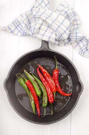 cast iron red: grilled green and red chili in a cast iron pan
