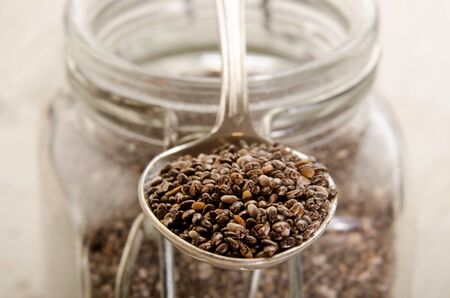 chia seed: closeup chia seed on a metal spoon Stock Photo