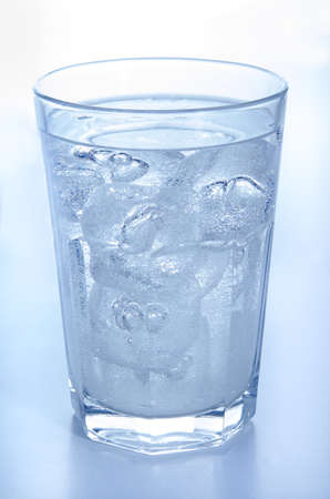 bubbling: one glass with ice cold, bubbling mineral water Stock Photo