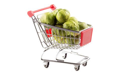 brussels sprouts: organic brussels sprouts in a small shopping trolley