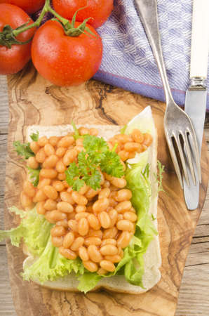 beans on toast: baked beans with salad and parsley on toast