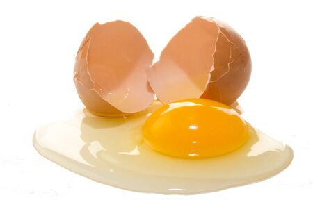 one broken free range egg on white background