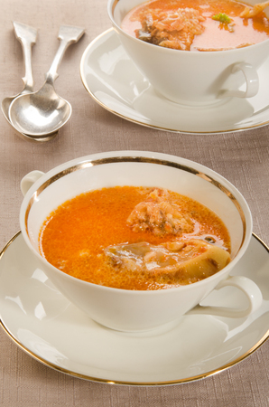 handled: creamy carp soup with sour cream in a double handled soup bowl Stock Photo