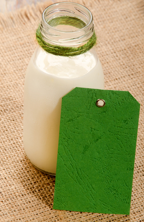 organic kefir in a bottle with green unmarked information sign