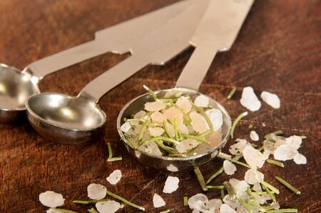 coarse: dried rosemary with coarse sea salt on a measurement spoon Stock Photo
