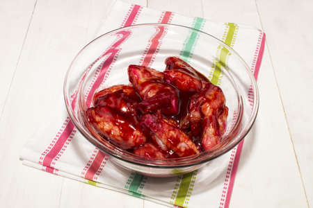 marinade: chicken wings in a glass bowl prepared with chinese marinade