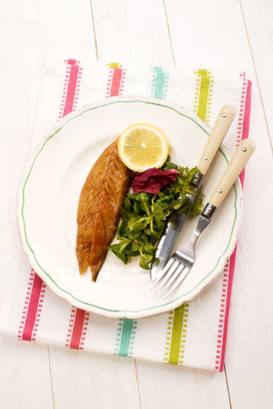 salad fork: gently smoked scottish mackerel with lemon and and salad, fork and knife on a plate