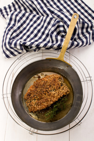 kipper: grilled scottish kipper coated with organic oatmeal and thyme in a pan