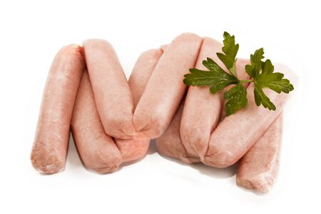 irish culture: home made scottish sausages with parsley on white background