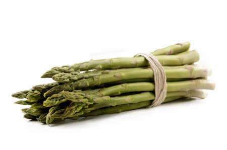 tied together: green fresh asparagus tied together with ribbon isolated on white background