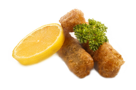 alaska pollock: deep fried fish finger made from alaska pollock fish with slice lemon and parsley isolated on white background Stock Photo