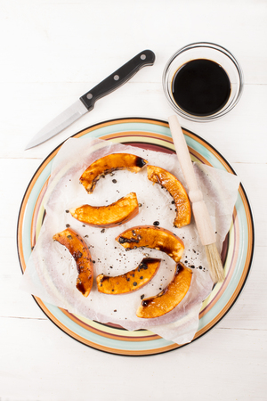 marinade: hokkaido pumpkin slices prepared with marinade on white kitchen paper Stock Photo