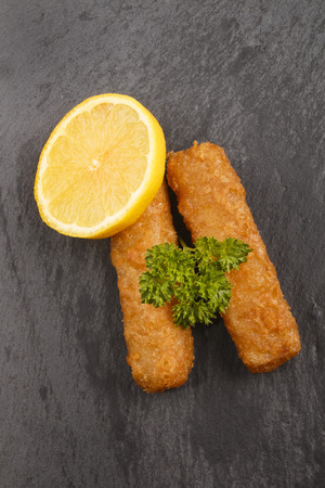 fishfinger: fish finger, slice lemon and wet parsley on slate