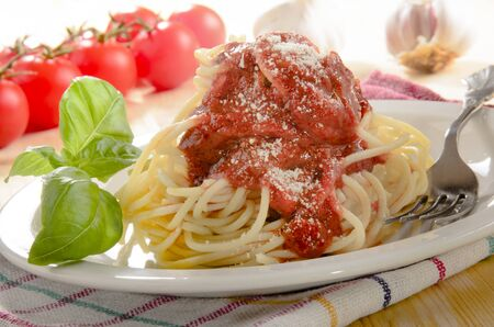 grated parmesan cheese: spaghetti with tomato sauce, basil and grated parmesan cheese