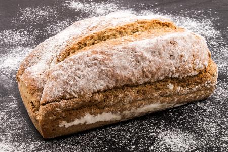 bread soda: freshly baked traditional irish soda bread with flour on slate