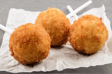 party food, fried potato balls on white kitchen paper