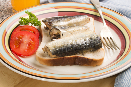 sardines in oil on a slice of fresh toast bread Stock Photo