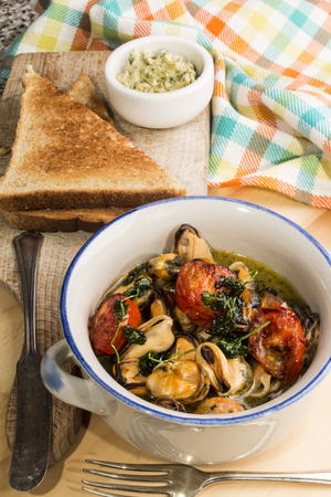 mussels with white wine, herb butter, roasted tomato and coriander