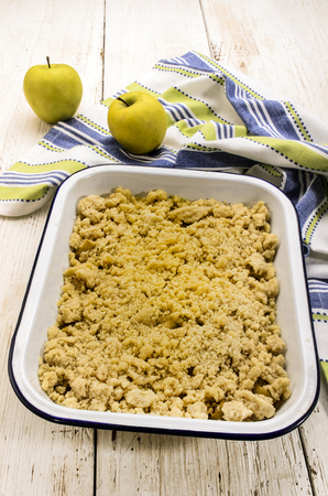 british apple crumble, freshly baked, in an white and blue enamel bowl Stock Photo