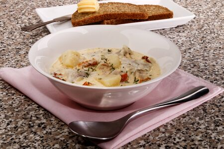 fine dinning, warm fish chowder with thyme and crushed peppercorn Stock Photo