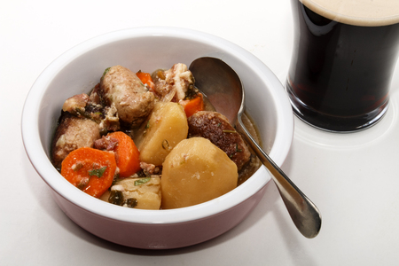 dublin coddle with carrot, potato and sausage in a bowl