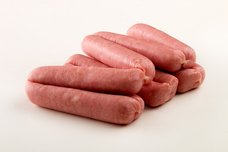 home made raw british pork sausages on bright background