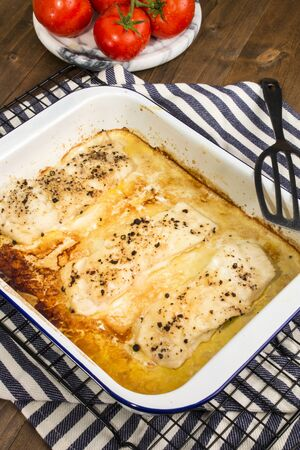 baked scottish cod in a blue and white enamel bowl