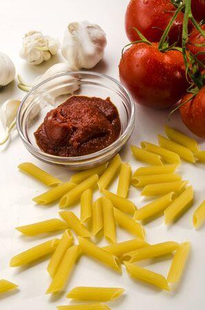 macaroni, tomato paste, garlic and fresh tomatoes to prepare an italian dish