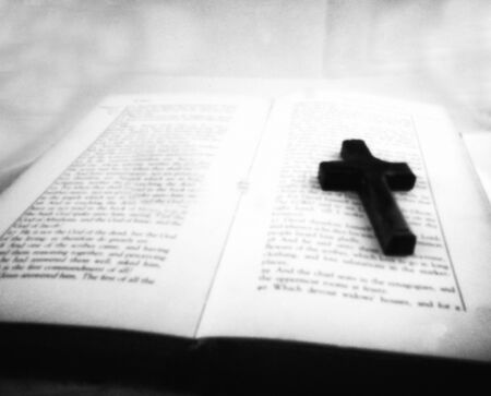 old religious book with holy cross - This black and white camera obscura photo is NOT sharp due to camera characteristic. Taken on analogue photographic paper with a professional pinhole camera