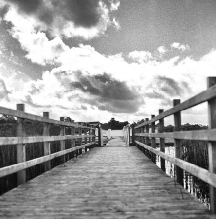Wooden boat jetty at a lake - This black and white camera obscura photo is NOT sharp due to camera characteristic. Taken on film with a pinhole camera