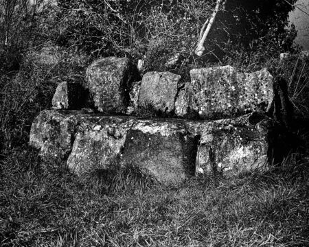 Bench built from ols natural stones - This black and white camera obscura photo is NOT sharp due to camera characteristic. Standard-Bild