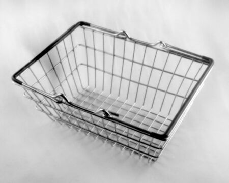 metal shopping basket on a light background, this black and white photo was taken with a pinhole camera, which corresponds to the camera characteristic
