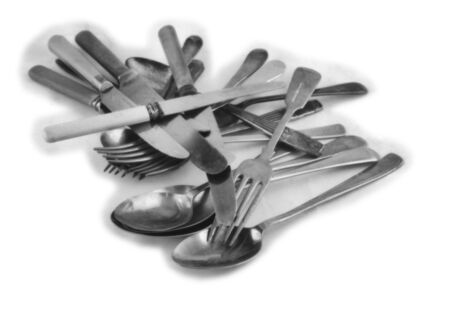 Cutlery, knife, fork and spoon on a light background, this black and white photo was taken with a pinhole film camera, which corresponds to the camera characteristic