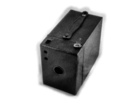 Old black vintage box camera on a white