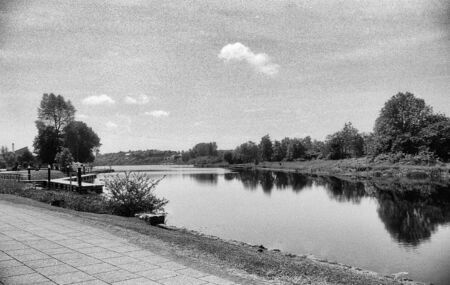 broad river on a sunny and almost cloudless day, this black and white photo was taken with a pinhole film camera, which corresponds to the camera characteristic Standard-Bild