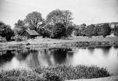 River Erne, Northern Ireland, County Fermanagh, and a very bright and sunny day, this black and white photo was taken with a pinhole film camera, which corresponds to the camera characteristic
