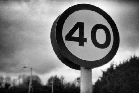 40 mph speed limit sign in United Kingdom - this picture was taken with an old analog camera and black and white film