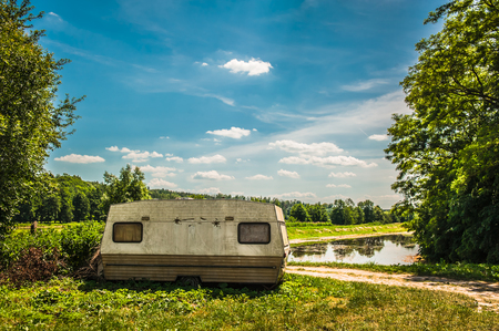 unused caravan standing on the side of the road Stock Photo