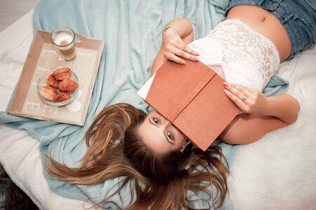Young woman relaxing at home Banco de Imagens