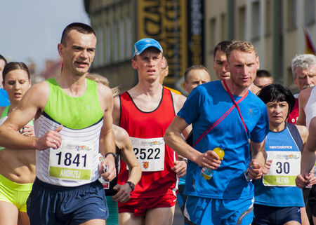 wet t shirt: Debno, Poland-April 6, 2014   Runners compete in the 41 Marathon Debno   Editorial
