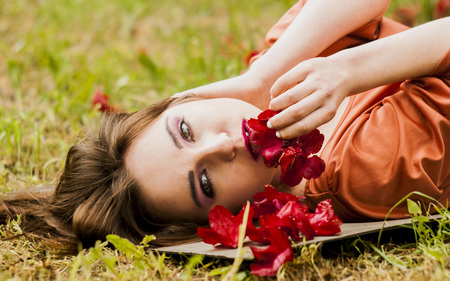 Sexy Model lying on grass photo