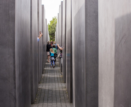 jewess: Berlin, Germany - Mai 30, 2014 Jewish Holocaust Memorial in Berlin  Tourists taking pictures Holocaust Memorial  German  Holocaust-Mahnmal , is a memorial in Berlin to the Jewish victims of the Holocaust It consists of a 19,000 m2 site covered with 2,711  Editorial