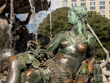 BERLIN, GERMANY - MAY 30, 2014 Neptunbrunnen  Neptune fountain  in Berlin It was built in 1891 and was designed by Reinhold Begas The Roman god Neptune is in the center  The four women around him represent the four main rivers of Prussia  Elbe, Rhine, Vis