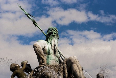 neptun: BERLIN, GERMANY - MAY 30, 2014 Neptunbrunnen  Neptune fountain  in Berlin It was built in 1891 and was designed by Reinhold Begas The Roman god Neptune is in the center  The four women around him represent the four main rivers of Prussia  Elbe, Rhine, Vis