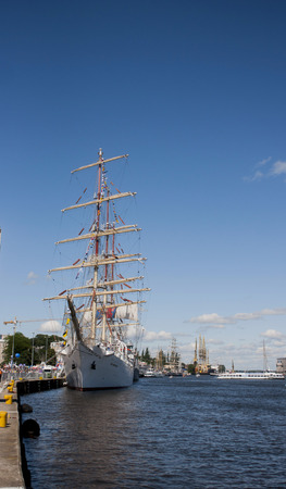 fill in: SZCZECIN, POLAND - JUNE 14, 2014  Sail Szczecin 2014 The tall masts of sailing ships fill the harbour for a wonderful three day event perfect for families and those who are sailors at heart  The event includes the largest yachts and sailing ships in the w Editorial