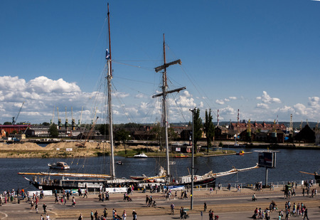 topsail: SZCZECIN, POLAND - JUNE 15, 2014  Sail Szczecin 2014 The tall masts of sailing ships fill the harbour for a wonderful event perfect for families and those who are sailors at heart View of ship  Wylde Swan  The Wylde Swan is the largest two-masted topsail