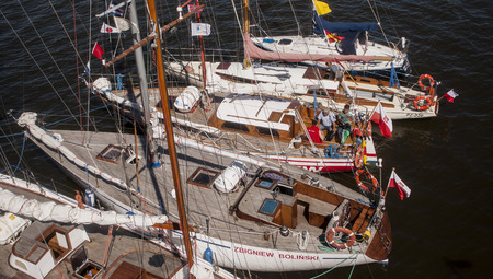 pirate crew: SZCZECIN, POLAND - JUNE 14, 2014  Sail Szczecin 2014 Group of yachts and boats in the harbor The tall masts of sailing ships fill the harbour for a wonderful three day event perfect for families and those who are sailors at heart  The event includes the l