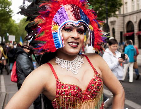bisexuals: BERLIN, GERMANY - JUNE 21, 2014 Christopher Street Day Crowd of people participate in the parade celebrates gays, lesbians, bisexuals and transgenders Prominent in the image are a elaborately dressed transgender  Editorial